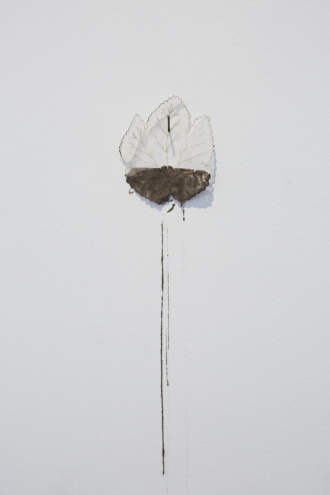 Conflict, embroidered silk leaf, rotten mud water, rusty stitch, variable dimensions, 2018