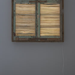 Incapsulated, blinded snutters, lights, audio Recording of a family during ordinary evening hours. 124 x 107 x 8,5 cm.